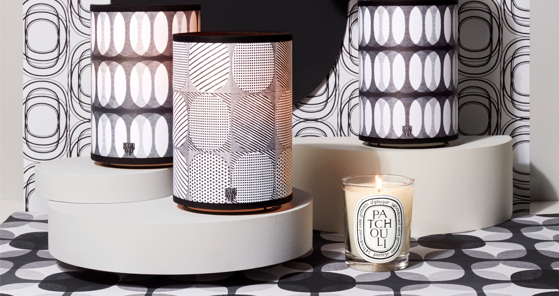 Visual of the diptyque candle shades on a graphic background